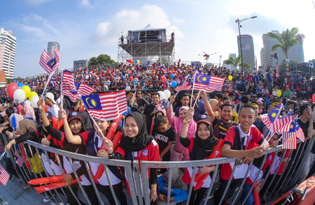 KUALA LUMPUR, MALAYSIA - AUGUST 31, 2016 : People waving Malaysia flag also known as Jalur Gemilang during Independence Day celebration or Merdeka Day at Merdeka Square. Redakční