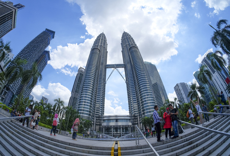 KUALA LUMPUR, MALAYSIA : JANUARY 10, 2015 : Tourist taking a picture with the background of Petronas Twin Towers.