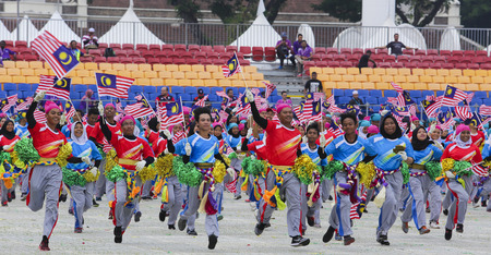 1malaysia: KUALA LUMPUR, MALAYSIA - AUGUST 29, 2016 : Performers waving Malaysia flag also known as Jalur Gemilang during full dress rehearsal of Independence Day celebration or Merdeka Day at Merdeka Square.