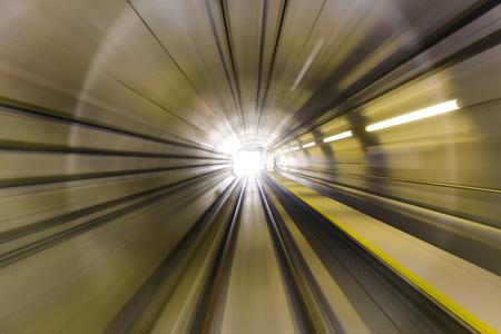 Motion blur  effect of Malaysia MRT (Mass Rapid Transit) train moving fast inside tunnel. MRT is a transportation for future generation.