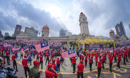 1malaysia: KUALA LUMPUR, MALAYSIA - AUGUST 31, 2016 : Performers waving Malaysia flag also known as Jalur Gemilang during Independence Day celebration or Merdeka Day at Merdeka Square.