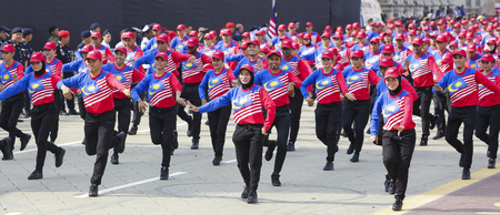 1malaysia: KUALA LUMPUR, MALAYSIA - AUGUST 31, 2016 : Performers wearing Malaysia flag patterned shirt also known as Jalur Gemilang during Independence Day celebration or Merdeka Day at Merdeka Square. Editorial