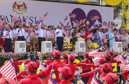 1malaysia: KUALA LUMPUR, MALAYSIA - AUGUST 31, 2016 : Malaysia Prime Minister, Najib Razak (C) waving Malaysia flag also known as Jalur Gemilang during Independence Day celebration or Merdeka Day at Merdeka Square.