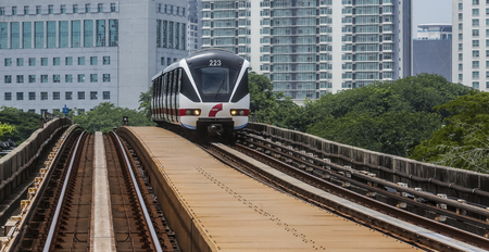 KUALA LUMPUR, MALAYSIA - SEPTEMBER 12, 2017 : Malaysia Light Railway Transit (LRT) train operated by Rapid Rail or service brand RapidKL. People commute with LRT as transportation to work and shopping.