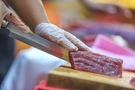 Fresh Tuna fish cut by professional Japanese chef to sliced Tuna fillet. Tuna can be a good source of omega - 3 fatty acids.