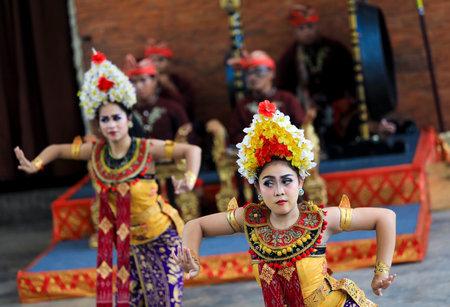 BALI, INDONESIA - NOVEMBER 15, 2017 : Women performing traditional Bali dance at Garuda Wisnu Kencana Cultural Park or GWK, a cultural park located at Ungasan Bali.