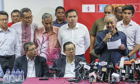KUALA LUMPUR, MALAYSIA - MAY 12, 2018 : Malaysian Prime Minister Mahathir Mohamad (r) announces in a press conference in Kuala Lumpur.