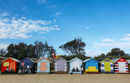 MELBOURNE, AUSTRALIA - MARCH 16, 2018 : Tourist at Melbourne iconic place, a colourful bathing boxes at Brighton Beach.