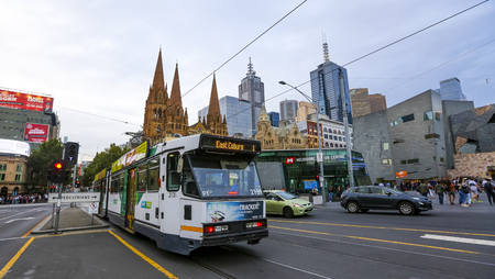 MELBOURNE, AUSTRALIA - MARCH 16, 2018 : Tram in Melbourne city center. Melbourne has the largest urban tramway network in the world. One of tourist attraction. Editorial