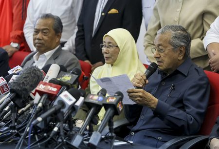 KUALA LUMPUR, MALAYSIA - MAY 17, 2018 : Malaysian Prime Minister Mahathir Mohamad (R) with his deputy, Wan Azizah Wan Ismail (2nd R) during press conference.