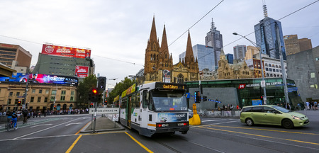 MELBOURNE, AUSTRALIA - MARCH 16, 2018 : Tram in Melbourne city center. Melbourne has the largest urban tramway network in the world. One of tourist attraction. 報道画像