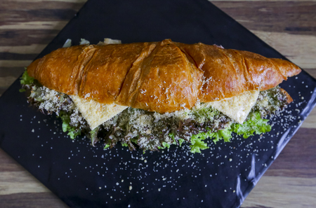 Delicious Croissant with salad and cheese