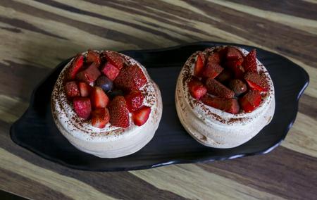 Delicious Strawberry Pavlova on table