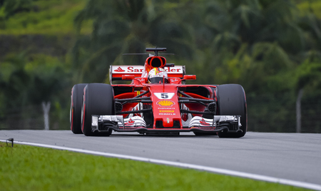 SEPANG, MALAYSIA : OCTOBER 01, 2017 : Sebastian Vettel of Germany driving the (5) Scuderia Ferrari on track during the Malaysia Formula One (F1) Grand Prix at Sepang International Circuit (SIC).