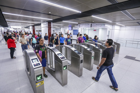 KUALA LUMPUR, MALAYSIA : JULY 17, 2017 : Passenger at entrance gate of Bukit Bintang Mass Rapid Transit (MRT) stations. MRT alleviate the severe traffic congestion in the KL metropolitan area.