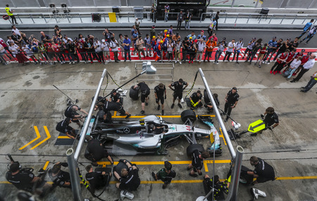 SEPANG, MALAYSIA -  SEPTEMBER 28, 2017 : Team members of Mercedes British driver Lewis Hamilton practice a pit stop ahead of the Malaysia Formula One (F1) Grand Prix at Sepang International Circuit (
