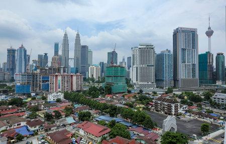 KUALA LUMPUR, MALAYSIA - JULY 18, 2018 : Kuala Lumpur skyline with view of Kampung Baru. Kampung Baru is a traditional village in Kuala Lumpur city centre. Editorial