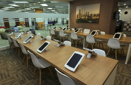 KUALA LUMPUR, MALAYSIA - AUGUST 07, 2018 : Smart library for reading ebook using computer tablet. Future technology for reading book. Editorial