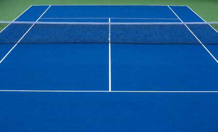 Outdoors blue tennis court.