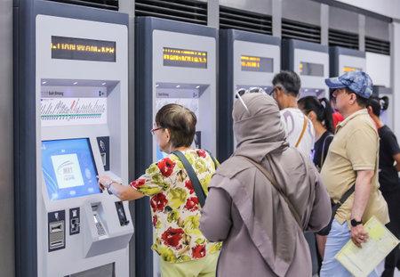 KUALA LUMPUR, MALAYSIA : JULY 17, 2017 : Passenger buying ticket from vending machines located at Bukit Bintang Mass Rapid Transit (MRT) stations.
