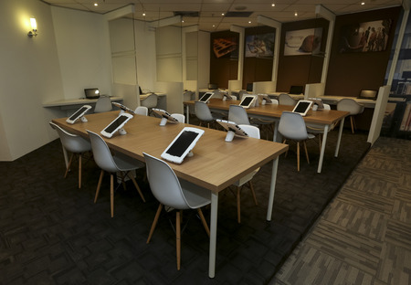 KUALA LUMPUR, MALAYSIA - AUGUST 07, 2018 : Smart library for reading ebook using computer tablet. Future technology for reading book. 報道画像