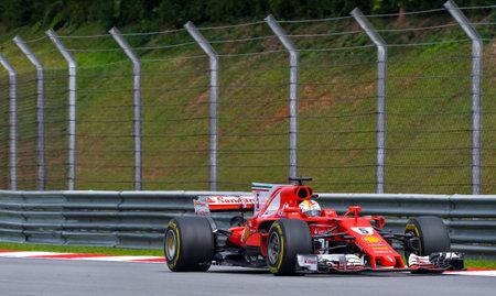 SEPANG, MALAYSIA : OCTOBER 01, 2017 : Sebastian Vettel of Germany driving the (5) Scuderia Ferrari on track during the Malaysia Formula One (F1) Grand Prix at Sepang International Circuit (SIC).