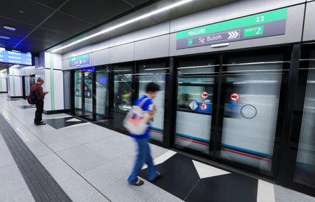 KUALA LUMPUR, MALAYSIA - AUGUST 01, 2017 : Passenger waiting for Malaysia MRT (Mass Rapid Transit) train at Maluri Station. MRT is a new transportation for future generation in Malaysia.