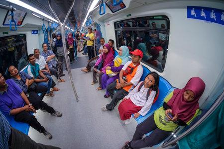 KUALA LUMPUR, MALAYSIA - JULY 17, 2017 : Passenger inside Malaysia MRT (Mass Rapid Transit) train at Bukit Bintang Station. MRT is a new transportation for future generation in Malaysia. 報道画像