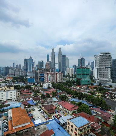 KUALA LUMPUR, MALAYSIA - JULY 18, 2018 : Kuala Lumpur skyline with view of Kampung Baru. Kampung Baru is a traditional village in Kuala Lumpur city centre. 報道画像
