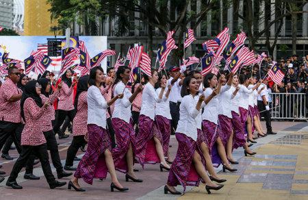 PUTRAJAYA, MALAYSIA - AUGUST 31, 2018 : Participant waving Jalur Gemilang flag during National Day celebration parade in Putrajaya. Celebrating the 61th anniversary of independence or Merdeka Day.