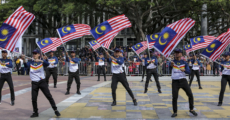 PUTRAJAYA, MALAYSIA - AUGUST 31, 2018 : Participant carry Jalur Gemilang flag during National Day celebration parade in Putrajaya. Celebrating the 61th anniversary of independence or Merdeka Day.