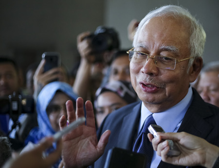 KUALA LUMPUR, MALAYSIA - SEPTEMBER 20, 2018 : Former Malaysia's prime minister, Najib Razak (C) speaks to journalists after a court appearance in Kuala Lumpur Courts Complex. Editorial