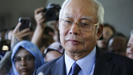 KUALA LUMPUR, MALAYSIA - SEPTEMBER 20, 2018 : Former Malaysia's prime minister, Najib Razak (C) reacts as he speaks to journalists after a court appearance in Kuala Lumpur Courts Complex.