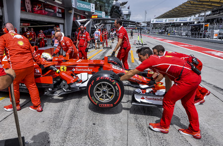 SEPANG, MALAYSIA : SEPTEMBER 30, 2017 : The Scuderia Ferrari team work on the car of Sebastian Vettel in the Pitlane during the Malaysia Formula One (F1) Grand Prix at Sepang International Circuit.