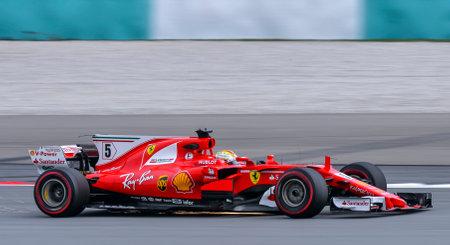 SEPANG, MALAYSIA - SEPTEMBER 29, 2017 : Sebastian Vettel of Germany driving the (5) Scuderia Ferrari on track during the Malaysia Formula One (F1) Grand Prix at Sepang International Circuit (SIC). 報道画像