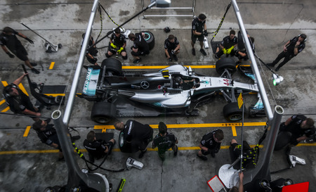 SEPANG, MALAYSIA - SEPTEMBER 28, 2017 : Team members of Mercedes British driver Lewis Hamilton practice a pit stop ahead of the Malaysia Formula One (F1) Grand Prix at Sepang International Circuit (SIC).