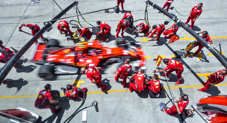 SEPANG, MALAYSIA : SEPTEMBER 30, 2017 : Team members of Kimi Raikkonen of Scuderia Ferrari practice a pit stop ahead of the Malaysia Formula One (F1) Grand Prix at Sepang International Circuit (SIC). 新闻类图片