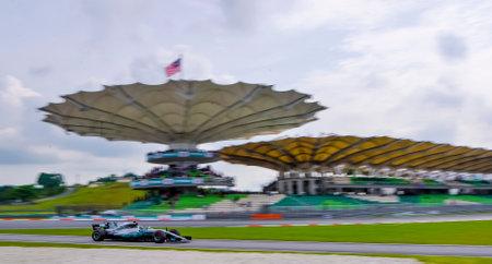 SEPANG, MALAYSIA - SEPTEMBER 29, 2017 : Valtteri Bottas of Finland driving the (77) Mercedes AMG Petronas on track during the Malaysia Formula One (F1) Grand Prix at Sepang International Circuit. Редакционное