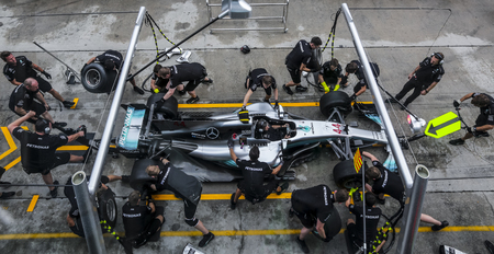 SEPANG, MALAYSIA - SEPTEMBER 28, 2017 : Team members of Mercedes British driver Lewis Hamilton practice a pit stop ahead of the Malaysia Formula One (F1) Grand Prix at Sepang International Circuit (SI