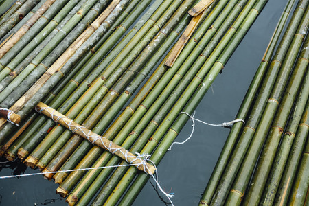 Bamboo raft, a traditional way to travel by water to discover peace environment of Royal Belum Rainforest acrossing the Temenggor Lake at Pulau Banding, Perak. Reklamní fotografie