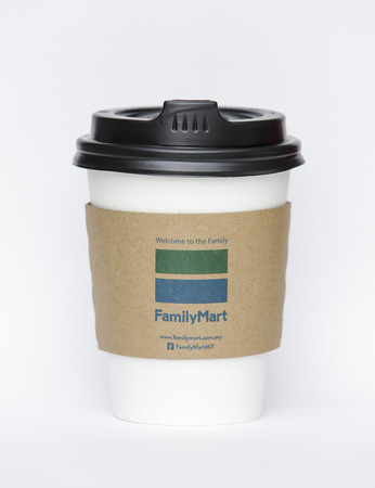 KUALA LUMPUR, MALAYSIA - OCTOBER 02, 2017 : FamilyMart paper cup for hot coffee Latte, Americano, Cappuccino & Mocha. FamilyMart is a Japanese convenience store franchise chain.