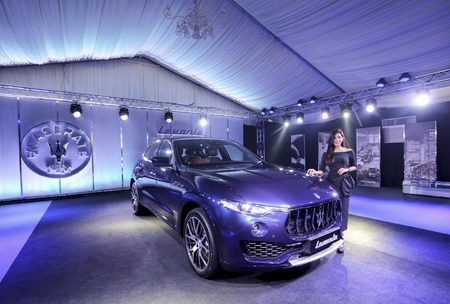 KUALA LUMPUR, MALAYSIA - NOVEMBER 24, 2017 : Model poses with Maserati Levante S GranLusso Sport Utility Vehicle (SUV). Editorial