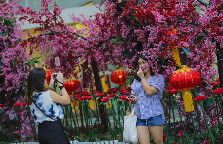 KUALA LUMPUR, MALAYSIA - FEBRUARY 05, 2016 : Tourist selfie with decoration of red lantern ahead of Chinese New Year celebration.