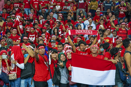 SELANGOR, MALAYSIA - AUGUST 26, 2017 :  Indonesia football fans during men's football Group B round match of the 29th Southeast Asian Games (SEA Games) between Indonesia against Malaysia at Shah Alam Stadium.