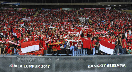 SELANGOR, MALAYSIA - AUGUST 26, 2017 :  Indonesia football fans during mens football Group B round match of the 29th Southeast Asian Games (SEA Games) between Indonesia against Malaysia at Shah Alam Stadium.