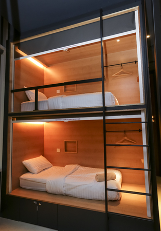KUALA LUMPUR, MALAYSIA - OCTOBER 12, 2017 : Capsule bedroom, bed in box  or pod. Small simple bedroom interior design with modern and luxury style.