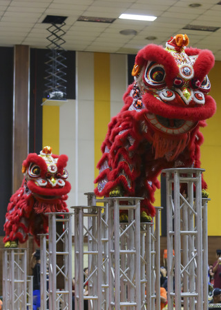 Traditional Lion Dance performance ahead of Chinese New Year celebration. Stok Fotoğraf
