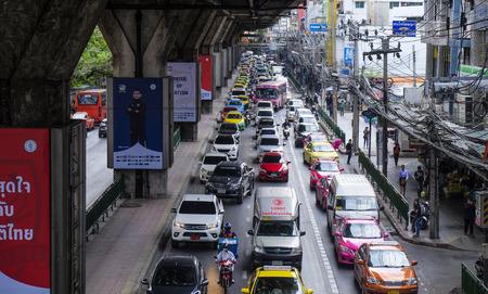 BANGKOK, THAILAND - APRIL 07, 2017 : Traffic moves slowly along a busy road in Bangkok city center, Thailand.