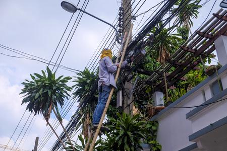 Electricity Worker fix problem at Bangkok, Thailand.