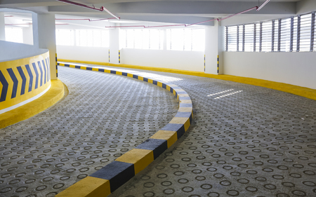 Empty spiral  curving shaped ramp entrance and exit of indoor car parking lots.